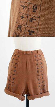 vintage 1920s or 1930s high waisted shorts with a print of little men performing exercises | http://www.rococovintage.com