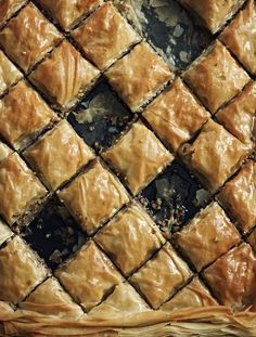 Mixed nut & honey baklava / * 100 g walnuts  * 100 g almonds  * 100 g pistachios  * 2 tsp ground cinnamon  * 1/2 tsp ground cloves  * 200 g butter, melted  * 2 X 270g packets (12 sheets) of filo pastry  * 300 g sugar  * 100 ml Greek honey  * 1 cinnamon stick  * 2 strips of orange zest