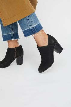 Vegan Heel Boot   In a low-rise silhouette, these vegan leather boots are a wardrobe staple...they look great with everything!   * Exposed zip closure * Stacked heel * Padded footbed * Rubber outsole