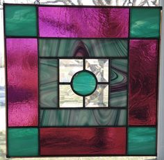 A personal favorite from my Etsy shop https://www.etsy.com/listing/290599729/handmade-stained-glass-panel-purple-and