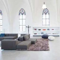 Saint Jakobus Church, renovated into a modern, contemporary home with respect for the church's original features.