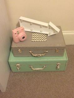 Retro bedroom accessories. Rustic suitcases, light box, Instax camera