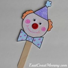 You can download the template for this clown puppet for FREE on this site. There are also MORE super-cute circus crafts.