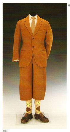 """1924 rust Harris tweed golfing suit. Jacket by Scholte of London, trousers by Forster & Sons. Jacket has a convertible collar for cold weather.  Trousers """"cut high in the waist"""" and originally supported by an inner elasticated girdle to maintain a looser hang.  The hems curve under to fasten to the cotton plus-four lining. Via 42ndblackwatch.com/."""