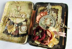 Alberto Juarez created this sweet mini-album in a tin and added a few of our vintage blooms to make this a stunner!