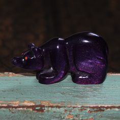 Zuni artist, Brian Yatsattie created this marvelous, stylized bear. Hand carved out of bowlerite with coral eyes, the bear's head is slightly turned and he looks alert. Zuni bear fetishes are a symbol of strength,...