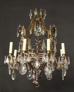 Bagues style gilt iron eight light chandelier w amethyst and clear crystal Italy 20th century