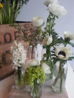 Mini milk bottles with spring whites Mini Milk Bottles, Centerpieces, Table Decorations, Summer Parties, Flower Fashion, Glass Vase, Bloom, Wedding Tables, Crafty