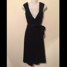FINAL price- DVF black wrap midi wool dress Diane von Furstenburg black wrap midi dress. Ribbon wraps around waist. Hooks onto ribbon loops. Dry clean. Wool. Silk ribbon and elastane. 40 inches long. Tag reads size 0. This is the final price, please no offers on this item. Bin #5 Diane von Furstenberg Dresses Midi