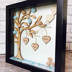Family Tree Frame Beautifully personalised family tree frame made of the highest quality and making a wonderful gift for birthdays, weddings or simply because. Measuring 25cm x 25cm the frame is designed with a large wooden family tree with up to six hanging heart names. Each