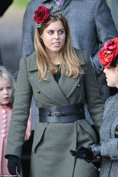 Princess Beatrice teamed a military-style coat, which was cinched in at the waist with a thick black belt