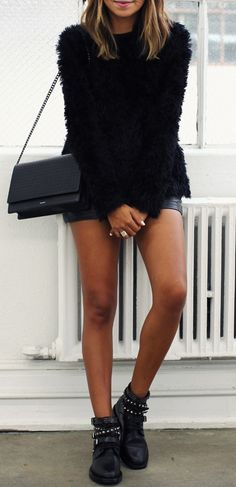Julie Sarinana is wearing a black fluffy sweater from Maurie & Eve