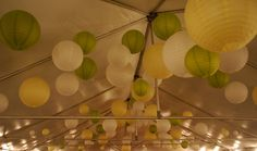 Hanging paper lanterns in different sizes in white, green and yellow colors Event Design and Florals: Limani Designs limanidesigns.com