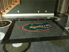 Through concrete resurfacing, the concrete overlay system used for this floor turned one sports fan's dream into reality. Concrete Resurfacing, Concrete Floors, Floor Coatings, Concrete Overlay, Decorative Concrete, Stl Cardinals, Concrete Design, Florida Gators, Commercial Design