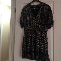Free people dress Free people dress with gold metallic Aztec design. Open flutter short sleeves, drawstring cinched waist and v neck top! Super cute with a pair of wedge sandals or flats! Make an offer no price is set! Free People Dresses Mini