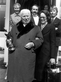 Charles Chaplin and Wife Oona Oneil with his honorary Oscar. 1972