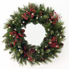 Cordless LED pre-lit wreath from Brookstone---perfect on our big mirror above the FP mantle