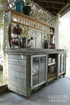 love the use of the old windows - could do that with the windows that I have in the basement. DIY: How To Build a Potting Bench using Salvaged Windows and Reclaimed Wood - via Remodelaholic Station D'empotage, Potting Station, Potting Bench Plans, Potting Tables, Potting Sheds, Potting Bench With Sink, Outdoor Potting Bench, Outdoor Buffet, Outdoor Sinks