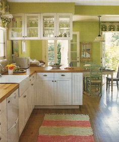 "I love the colors in this kitchen...very ""springtime""! Feels like you need to come on in & get a cold glass of sweet tea...Love the open-air feel of this lay-out."