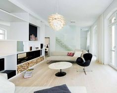 suelos de madera dinesen sofás piero lissoni sillón Swan de Arne Jacobsen mesa Tulip de Eero Saarinen lámpara Artichoke de Poul Henningsen d...Nice big house!