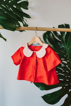 E a c h . P e a c h . B l o u s e  Sweet as a peach blouse with buttons up the front and a feature petal collar. Cap sleeves and cropped style.