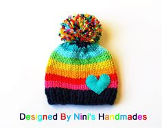 Knit Rainbow Pom Pom Hat #rainbow hats #pom pom hats #colorful pom pom hats for all ages #ninishandmades #buy handmade #made in the usa #handmade winter hats #ski hat