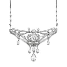 Diamond pendent necklace, early 20th century The central segment of arabesque design set with circular-, single-cut, cushion-, marquise-, pear-shaped and oval diamonds, on a detachable knife edge and fine link chain accented with circular-cut diamonds, length approximately 430mm, fitted case.