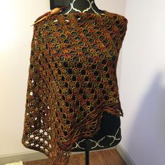Pattern is Weekend Wrap by Tammy Hildebrand and the yarn is Malabrigo Arroyo. Hard to photograph. Much prettier in person