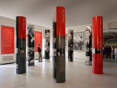 Common pillars wrapped with photos, information, etc.  Not sure where these would go in our office building, though?