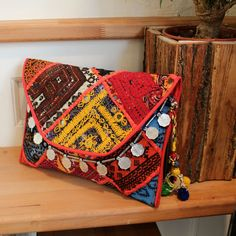 BOMBAY by NAWERI 119€ Boho clutch made from antique embroidered fabrics with a removable strap. Pochette confectionnée à partir de tissus brodés antiques. Chaîne amovible. Modèle unique.