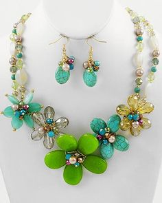 This is a pretty flower design, with turquoise semi-precious stones.