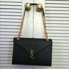 Saint Laurent Large Monogram Leather Shoulder Bag authentic Saint Laurent bag is made of 100% calfskin leather. This leather does not scratch and kept it in excellent condition.There are no scratches or markings! This can be carried on the shoulder or as a cross body!  Will sell for less on ️️ Details: Dimensions: 12.1 x 8.6 x 2.9 INCHES length of handle: 11.7 inches 100% calfskin leather Metal chain strap can be doubled Grosgrain lining Magnetic snap closure Gold-toned hardware Interior zip…