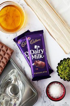 Chocolate Baklava Bracelets (Asawer El Sit) | Cleobuttera Chocolate Baklava, Cadbury Chocolate, Love Chocolate, Arabic Dessert, Arabic Sweets, Chocolate Lovers Quotes, Ramadan Sweets, Dairy Milk Silk, Milk Photography