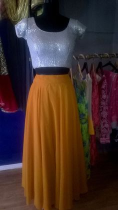Be the girl with glitters all over you with pretty silver blouse and mustard long skirt to complement it  #bridesmaiddress #cocktaildress #indowestern #indian #philicia #traditional #ethnic #silver #mustard comment or message us more more information (no reference picture or re-pin,100%original picture and our own designs)