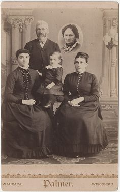 Gone But Not Forgotten - Cabinet Card of a Family in mourning with portrait of a departed Woman printed in as a vignette.