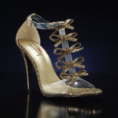 BE DAZZLED GOLD by LUICHINY   This high heel can be worn by anyone and look sexy! It is a great choice for a unique shoe for any occasion. Your foot will be secure with a full coverage clear straps and the gold glitter fabric will be sure to turn heads. The knotted bow t-strap accents are glamorous and one-of-a-kind. $68 promshoes.com Gold Prom Shoes, Wedding Shoes, Glitter Fabric, Gold Glitter, Stiletto Heels, High Heels, Metallic Shoes, Bridesmaid Shoes, Unique Shoes