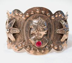 Amazing Gypsy cuff....most jewelry has not survived due to hardship, and fine metals were melted down to survive. Jewelry was considered a portable bank account, and Gypsys would wear there wealth so to speak.  Most jewelry synthetic stones were used because they were difficult to authenticate.  Most jewelry was made with 14K gold.