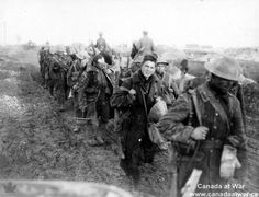 """WWI: These Canadian soldiers are returning from """"up the line."""" They are mud-splattered and weary, but look relieved to be marching away from the shelling at the front. - Found via Canada at War"""