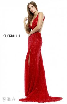 Sexy in sequins, this stunning Sherri Hill 32010 gown has a plunging V neckline with an exposed back and sultry thigh high slit. This gown will be gorgeous at prom, a pageant, formal gala or winter ball. Sparkle and shine all night long in this alluring gown!