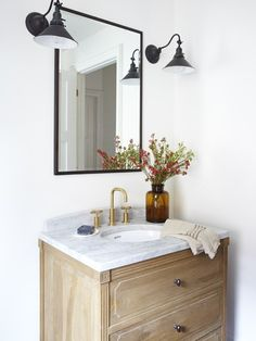 Natural wood, black sconces, and brass faucet. Inside a Toronto Row House With Elegant, Eclectic Style via Casa Hygge, Row House Design, Canadian House, Home Interior, Interior Design, Bleached Wood, Wood Vanity, Diy Vanity, Vanity Ideas