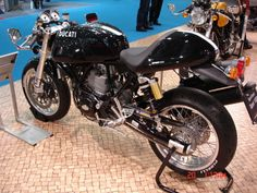 a ducati cafe racer - Sam Flynn's (Tron) look a like bike  This is what I want!!!