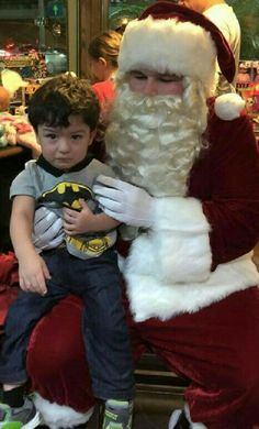 Lil Josh (2yr) Sitting on Santa's lap during the 2015 Christmas season.  Cant wait to see his face Christmas morning, when he gets his new rocking horse.