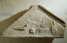 Relief of tympanum with butcher's tools - L'Aquila, Museo Naz. d'Abruzzo