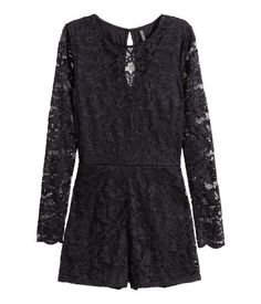 Jumpsuit in lace with long sleeves and short legs. Opening at back of neck with button, concealed back zip, and seam at waist. Partly lined in jersey.