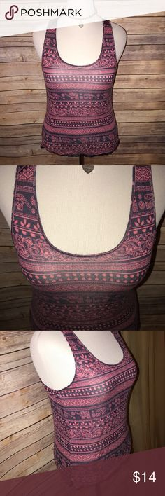Pink Rose Dusty Rose/Navy Tribal/Elephant Tank Super cute and fun! Great dusty Rose and navy color combo in a striped tribal pattern with elephants. Very ethnic/BOHO style. Stretchy and soft fabric. Excellent quality and condition. Check out my other listings to bundle and save 25% 😎! Pink Rose Tops Tank Tops