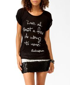 I like that she's wearing a written quote t (or just a grunge t shirt for that matter) with a sequin mini skirt