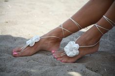 Barefoot sandals for beach weddings keep your feet both pretty and steady in the warm tropical sand. A bride's bare feet will be so sexy and elegantly compliment her beautiful beach wedding dress.