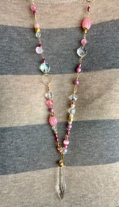 A vintage chandelier crystal and pink beads in all shapes in sizes form a very long necklace that can be wrapped and worn short, from the JadeAndRubies shop on Etsy: https://www.etsy.com/shop/JadeAndRubies?ref=hdr_shop_menu