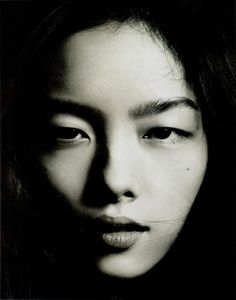 fei fei sun by hedi slimane 2012. b/w photograph, black and white, portrait, woman, face