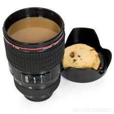 Camera Lens Mug -   Take a few tasty shots of espresso with the Camera Lens Mug. Designed to look and feel just like a regular camera lens, this detailed mug is great for the office or bringing the world into focus first thing in the morning.